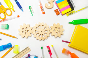 wooden gear on the creative school desk. educational process. mechanism interaction, principle of action. creativity and education system. development of young children. imagination, thinking